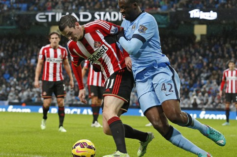 "Manchester City's Ivorian midfielder Yaya Toure (R) vies with Sunderland's English midfielder Adam Johnson during the English Premier League football match between Manchester City and Sunderland at the Etihad Stadium in Manchester, north west England, on January 1, 2015. AFP PHOTO / LINDSEY PARNABY  RESTRICTED TO EDITORIAL USE. No use with unauthorized audio, video, data, fixture lists, club/league logos or ""live"" services. Online in-match use limited to 45 images, no video emulation. No use in betting, games or single club/league/player publications. / AFP / LINDSEY PARNABY"