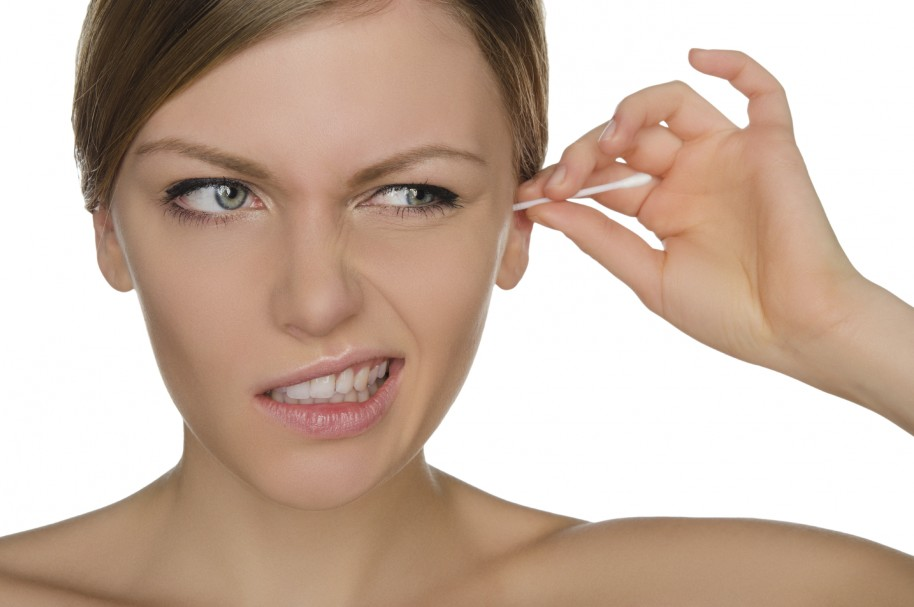 woman injured cleans ears with cotton sticks isolated on white