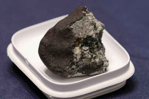 WASHINGTON, DC - JUNE 17:  A piece of the Chelyabinsk meteorite is displayed before a hearing of the House Administration Committee in the Longworth House Office Building on Capitol Hill June 17, 2015 in Washington, DC. Famously caught by a number of video cameras, the meteorite fell to earth February 15, 2013 and caused a large amount of damage in the city of Chelyabinsk, Russia.  (Photo by Chip Somodevilla/Getty Images)
