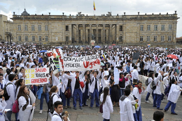 BOGOTA, COLOMBIA - OCTOBER 29:  Doctors, health workers, students and patients march in downtown Bogota to protest against a Health reform proposed by the government of Juan Manuel Santos on October 29, 2013 in Bogota, Colombia. (Photo by Gal Schweizer/LatinContent/Getty Images)