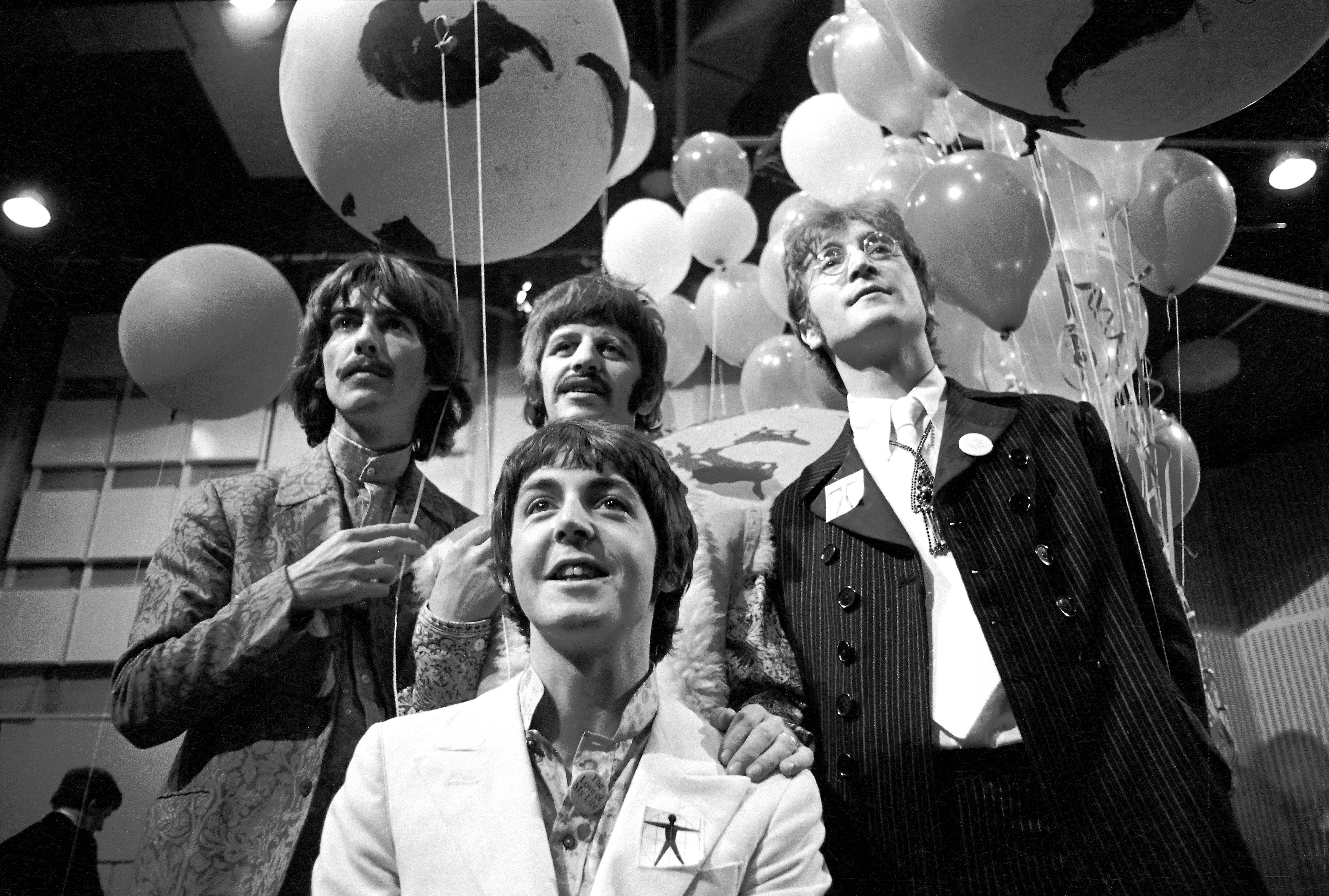 UNITED KINGDOM - JUNE 24: ABBEY RD STUDIOS Photo of BEATLES, George Harrison, Paul McCartney, Ringo Starr, John Lennon posed, group shot at press conference before performing All You Need Is Love on world satellite link up (Photo by Ivan Keeman/Redferns)