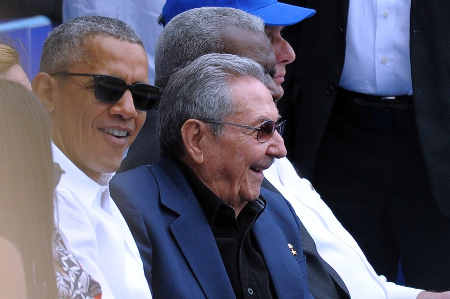 US President Barack Obama (L) and Cuban President Raul Castro attend a Major League baseball exhibition game at the Latinoamericano stadium in Havana on March 22, 2016. Obama and Castro sat side-by-side Tuesday for a symbolism-laden game of baseball between Cuba's national side and the Major League's Tampa Bay Rays.  AFP PHOTO /YAMIL LAGE / AFP / YAMIL LAGE