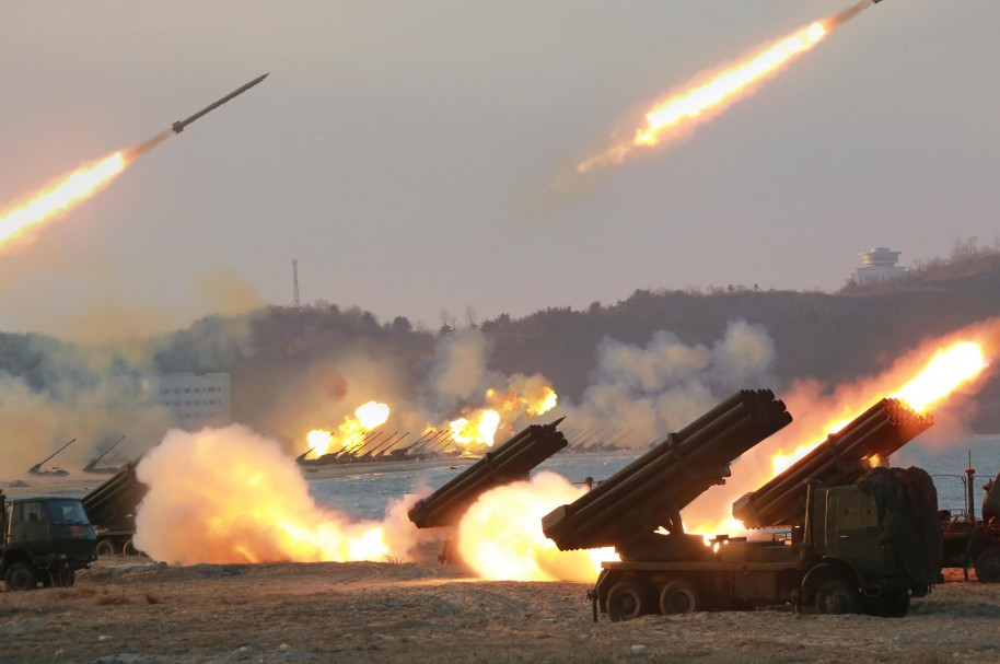"""This undated picture released from North Korea's official Korean Central News Agency (KCNA) on March 25, 2016, shows the large-scale intensive striking drill of long-range artillery pieces of the KPA large combined units at an undisclosed location in North Korea. / AFP / KCNA VIA KNS / KCNA / REPUBLIC OF KOREA OUT   ---EDITORS NOTE--- RESTRICTED TO EDITORIAL USE - MANDATORY CREDIT """"AFP PHOTO/KCNA VIA KNS"""" - NO MARKETING NO ADVERTISING CAMPAIGNS - DISTRIBUTED AS A SERVICE TO CLIENTS/ THIS PICTURE WAS MADE AVAILABLE BY A THIRD PARTY. AFP CAN NOT INDEPENDENTLY VERIFY THE AUTHENTICITY, LOCATION, DATE AND CONTENT OF THIS IMAGE. THIS PHOTO IS DISTRIBUTED EXACTLY AS RECEIVED BY AFP.   /"""