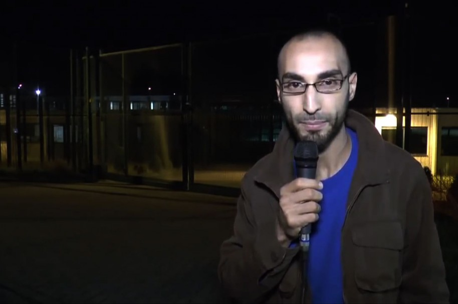 "This video grab made on March 26, 2016 from a video posted on YouTube in 2014 shows Faycal Cheffou, then calling himself an independent journalist demanding the authorities to respect the rights of asylum-seekers, and identified on March 26, 2016 by Belgium federal prosecutor as one of the main suspects of the March 22 Brussels attacks and charged with terrorist murder. Faycal Cheffou, believed to be the ""man in a hat"" pictured in CCTV footage alongside the two airport bombers, but whose device did not go off, is the first person to face terrorist offences over the bloodiest attacks ever to strike the symbolic capital of Europe. / AFP / Youtube / - / DATE AND PLACE UNIDENTIFIED BY AFP == VIDEO POSTED ON YOUTUBE BY FAYCAL CHEFFOU IN 2014 == RESTRICTED TO EDITORIAL USE - MANDATORY CREDIT ""AFP PHOTO / YOUTUBE""- NO MARKETING NO ADVERTISING CAMPAIGNS - DISTRIBUTED AS A SERVICE TO CLIENTS =="
