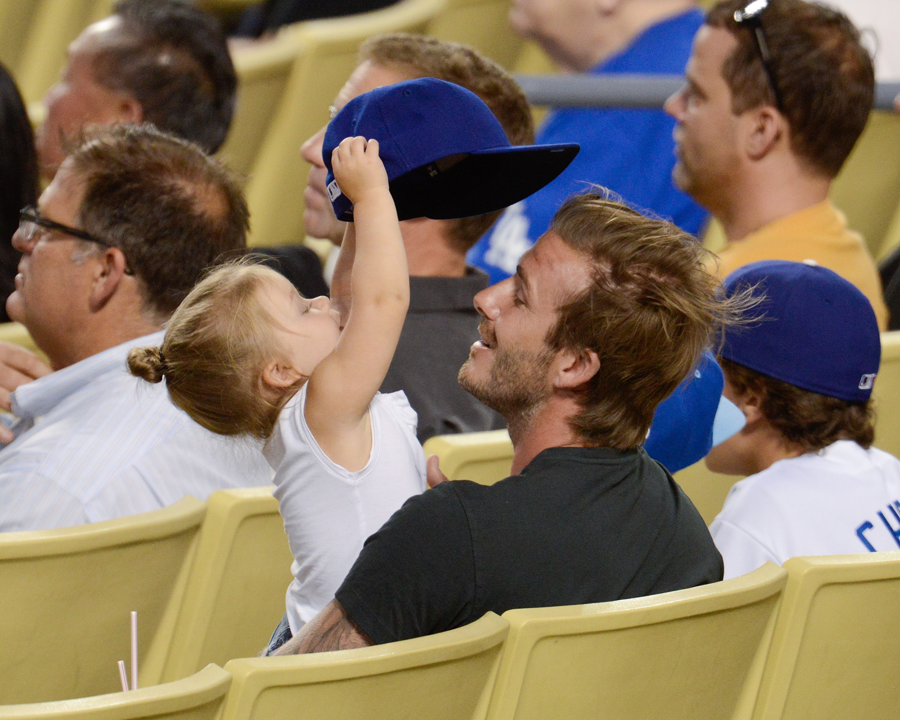 LOS ANGELES, CA - AUGUST 27: David Beckham (R) and daughter Harper Beckham attend a baseball game between the Chicago Cubs and the Los Angeles Dodgers at Dodger Stadium on August 27, 2013 in Los Angeles, California. (Photo by Noel Vasquez/Getty Images)