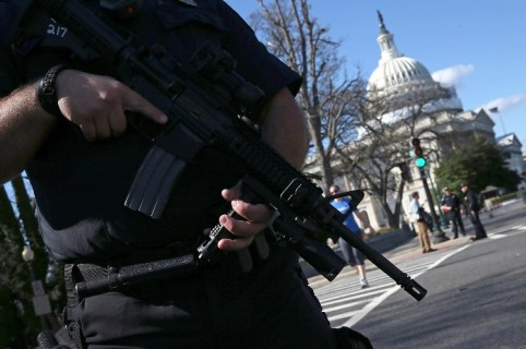 """WASHINGTON, DC - MARCH 28: Heavily armed U.S. Capitol police stand guard outside the U.S. Capitol after at least one person was shot in the Capitol Visitor Center March 28, 2016 in Washington, DC. The Capitol was placed in """"lock down"""" following the shooting.   Win McNamee/Getty Images/AFP"""