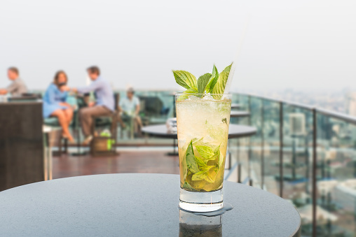 Mojito cocktail on table in rooftop bar