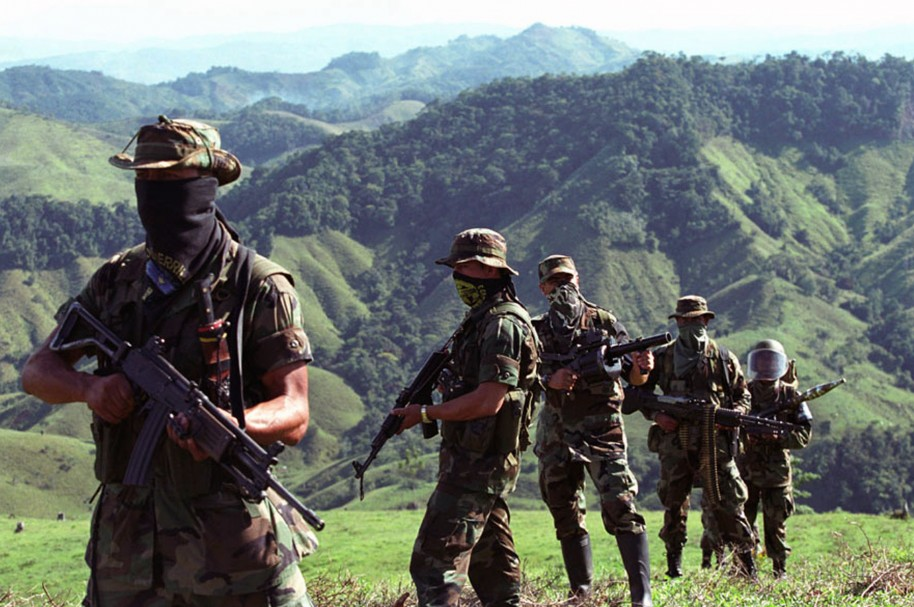 COLOMBIA - MARCH 07:  Paramilitary fighters patrol in the mountains of Antioquia, Colombia in this 2002 file photo.  (Photo by Scott Dalton/Bloomberg via Getty Images)