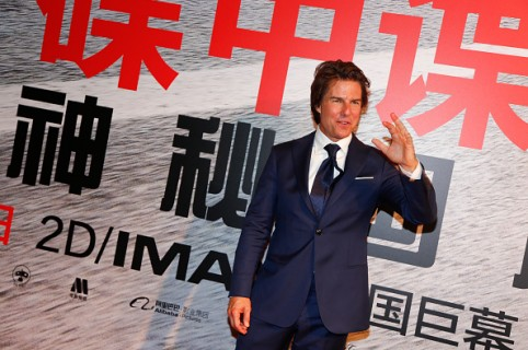 """SHANGHAI, CHINA - SEPTEMBER 06:  (CHINA OUT) American actor Tom Cruise poses during the premiere of Christopher McQuarrie's film """"Mission: Impossible - Rogue Nation"""" at Shanghai Film Art Center on September 6, 2015 in Shanghai, China.  (Photo by ChinaFotoPress/ChinaFotoPress via Getty Images)"""