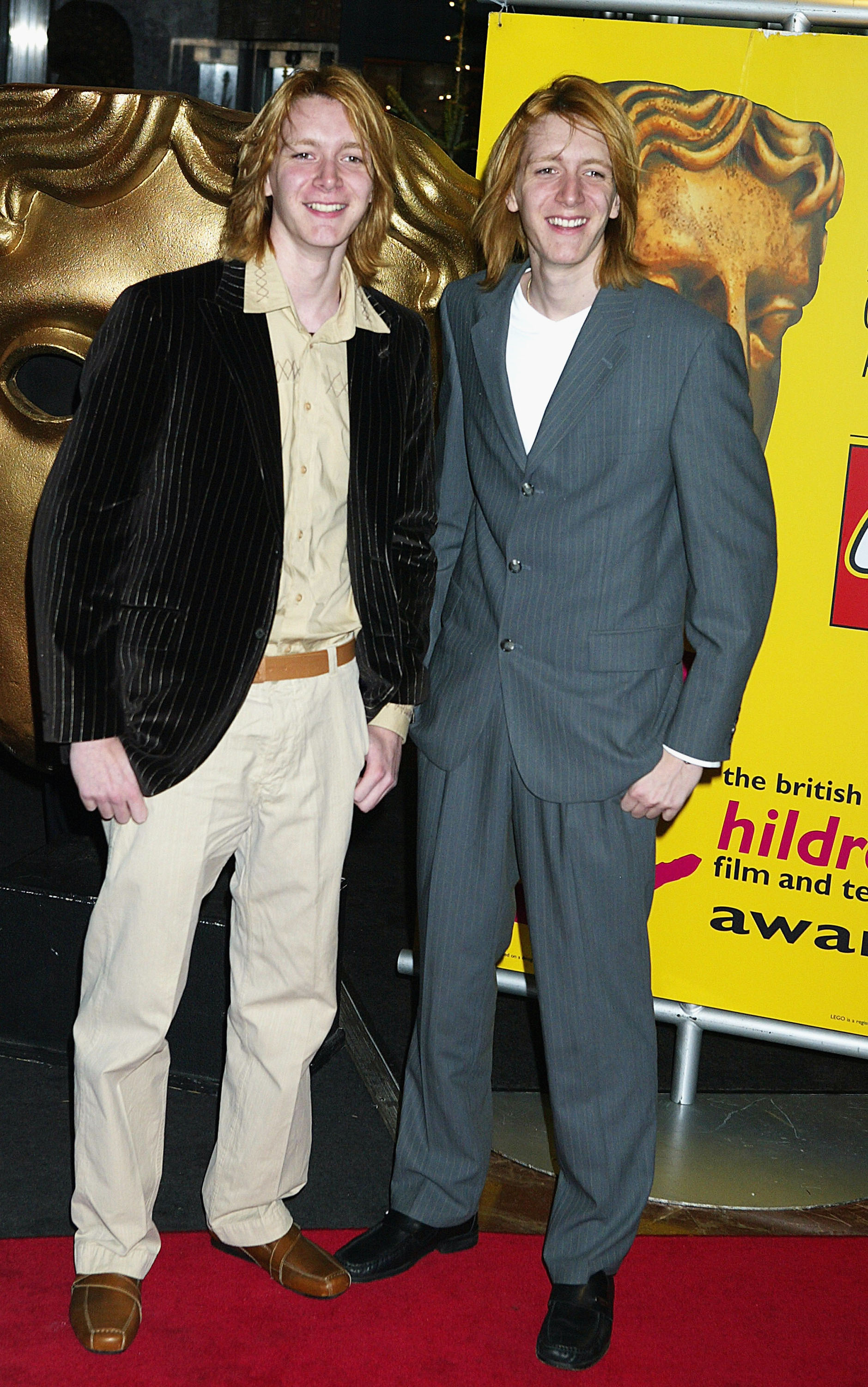 "LONDON - NOVEMBER 28: James and Oliver Phelps arrive at the ""British Academy Children's Film and Television Awards"" on November 28, 2004 at the London Hilton, Park Lane, in London. The annual awards reward excellence in the field of children's television and film. (Photo by Jo Hale/Getty Images)"