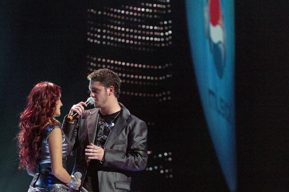 GLENDALE, AZ - FEBRUARY 01: Dulce Maria and Christopher Uckermann of RBD perform during the Pepsi Musica Super Bowl Fiesta at the Jobings.com Arena on February 1, 2008 in Glendale, Arizona. (Photo by Larry French/Getty Images for NFL)