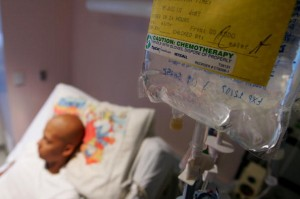 SAN FRANCISCO - AUGUST 18: Eighteen-year-old cancer patient Patrick McGill lies in his hospital bed while receiving IV chemotherapy treatment for a rare form of cancer at the UCSF Comprehensive Cancer Center Childrens Hospital August 18, 2005 in San Francisco, California. The UCSF Comprehensive Cancer Center continues to use the latest research and technology to battle cancer and was recently rated 16th best cancer center in the nation by US News and World Report. (Photo by Justin Sullivan/Getty Images)
