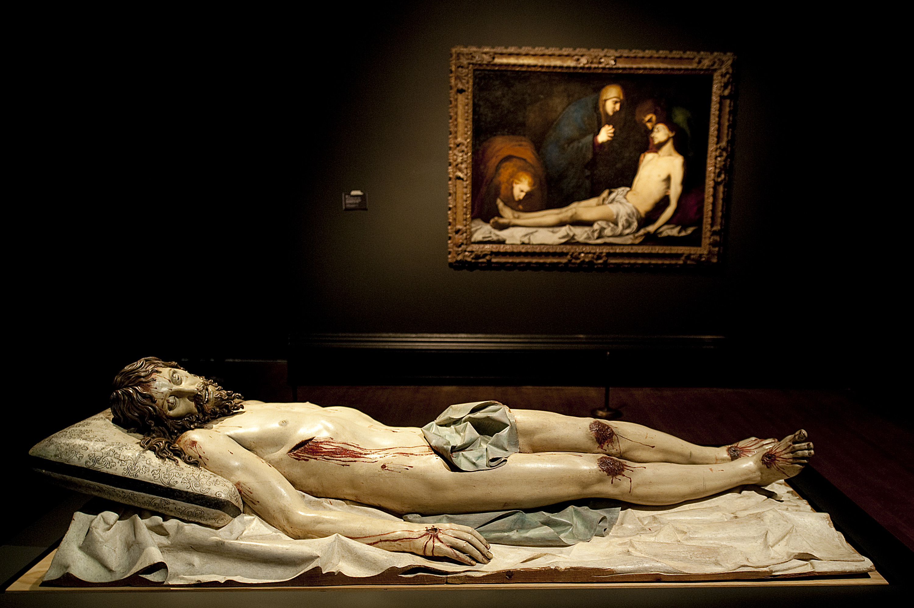 "'Dead Christ, 1625-30' by Gregorio Ferandez and unkown painter (front) and 'The Lamentation over the Dead Christ', early 1620s by Jusepe de Ribera (1591-1652) are seen as part of the fourth coming The Sacred Made Real"" exhibition at the National Gallery in Central London on October 16, 2009. AFP PHOTO/Ben Stansall / AFP PHOTO / BEN STANSALL"