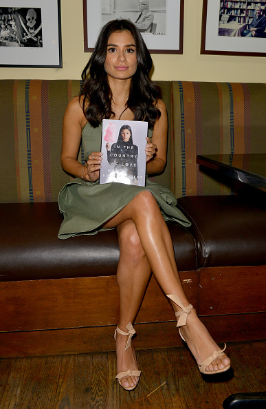 """CORAL GABLES, FL - MAY 05: Diane Guerrero signs copies of her book """"In the Country We Love: My Family Divided """" at Books and Books on May 5, 2016 in Coral Gables, Florida. (Photo by Johnny Louis/WireImage)"""