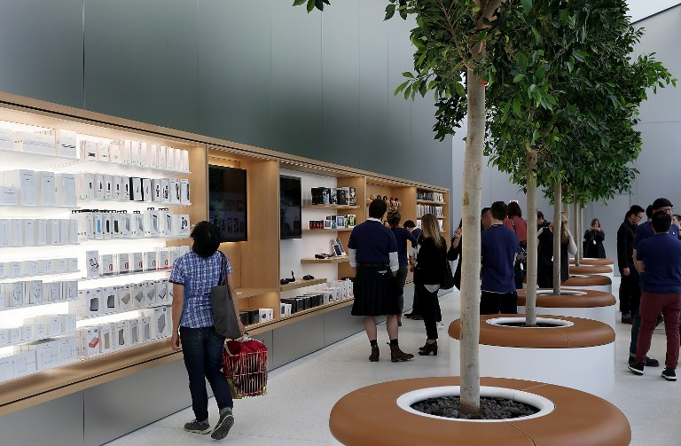 "SAN FRANCISCO, CA - MAY 19: Members of media tour the ""Genius Grove"" during a press preview of the new flagship Apple Store on May 19, 2016 in San Francisco, California. Apple is preparing to open its newest flagship store in San Francisco's Union Square on Saturday May 21. The new store features new design elements as well as community programs including the ""genius grove"" where where customers can get support under a canopy of local trees and ""the plaza"" a public space that will be open 24 hour a day. Visitors will enter the store through 42-foot tall sliding glass doors. Justin Sullivan/Getty Images/AFP"