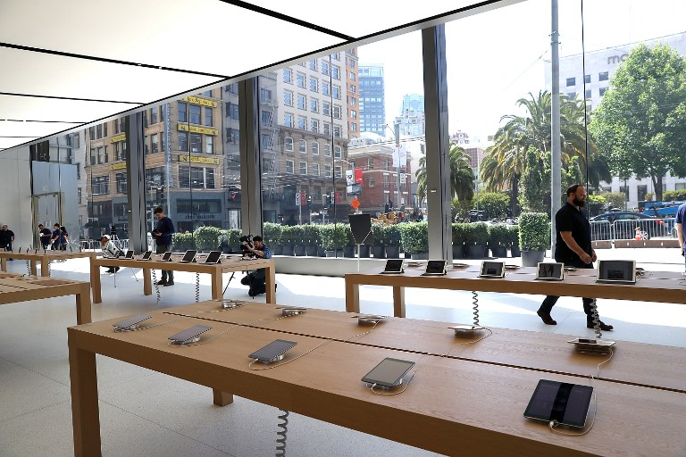 "SAN FRANCISCO, CA - MAY 19: A view of the new flagship Apple Store on May 19, 2016 in San Francisco, California. Apple is preparing to open its newest flagship store in San Francisco's Union Square on Saturday May 21. The new store features new design elements as well as community programs including the ""genius grove"" where where customers can get support under a canopy of local trees and ""the plaza"" a public space that will be open 24 hour a day. Visitors will enter the store through 42-foot tall sliding glass doors. Justin Sullivan/Getty Images/AFP"