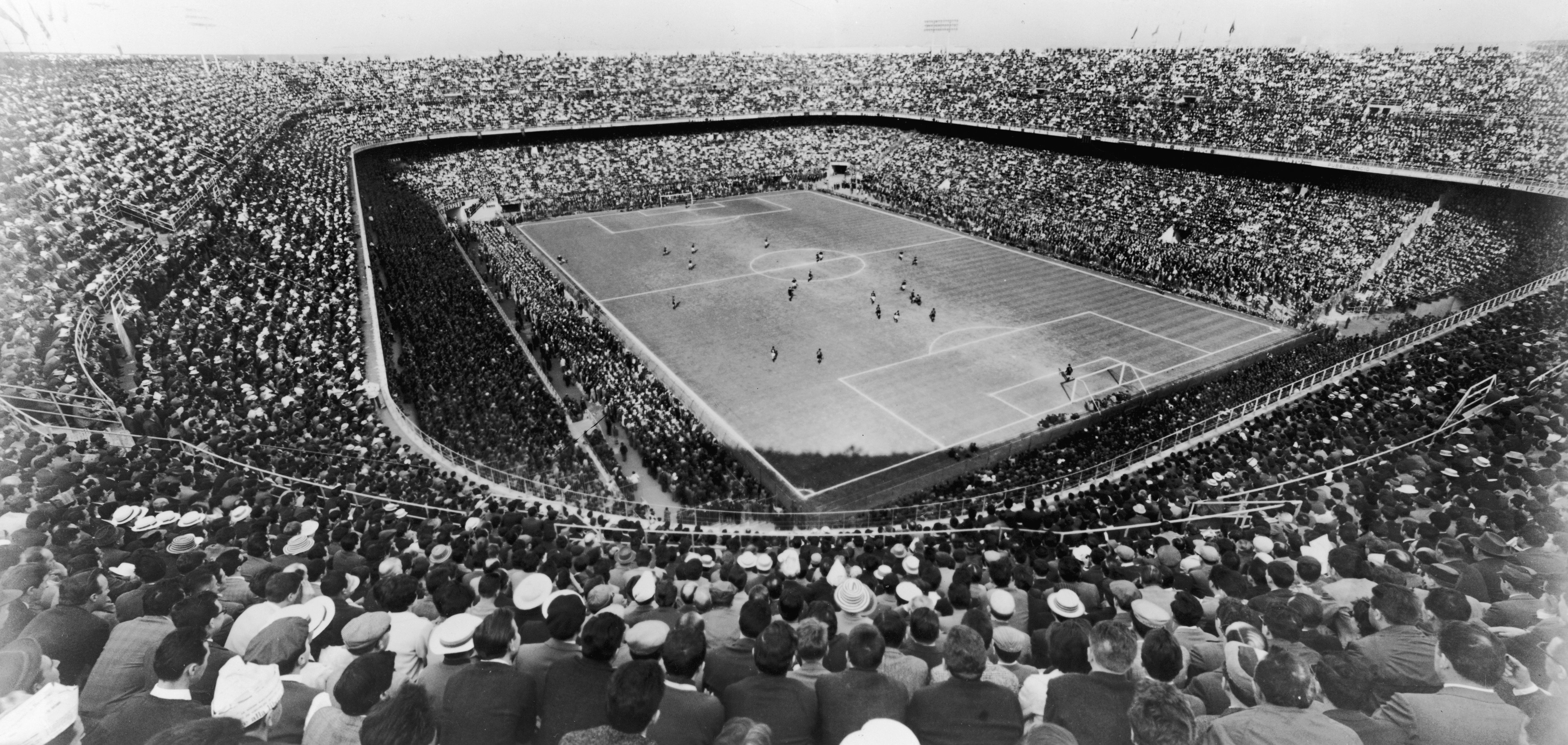 A large crowd watching a football match at the San Siro Stadium in Milan, originally built in 1926. (Photo by Keystone/Getty Images)