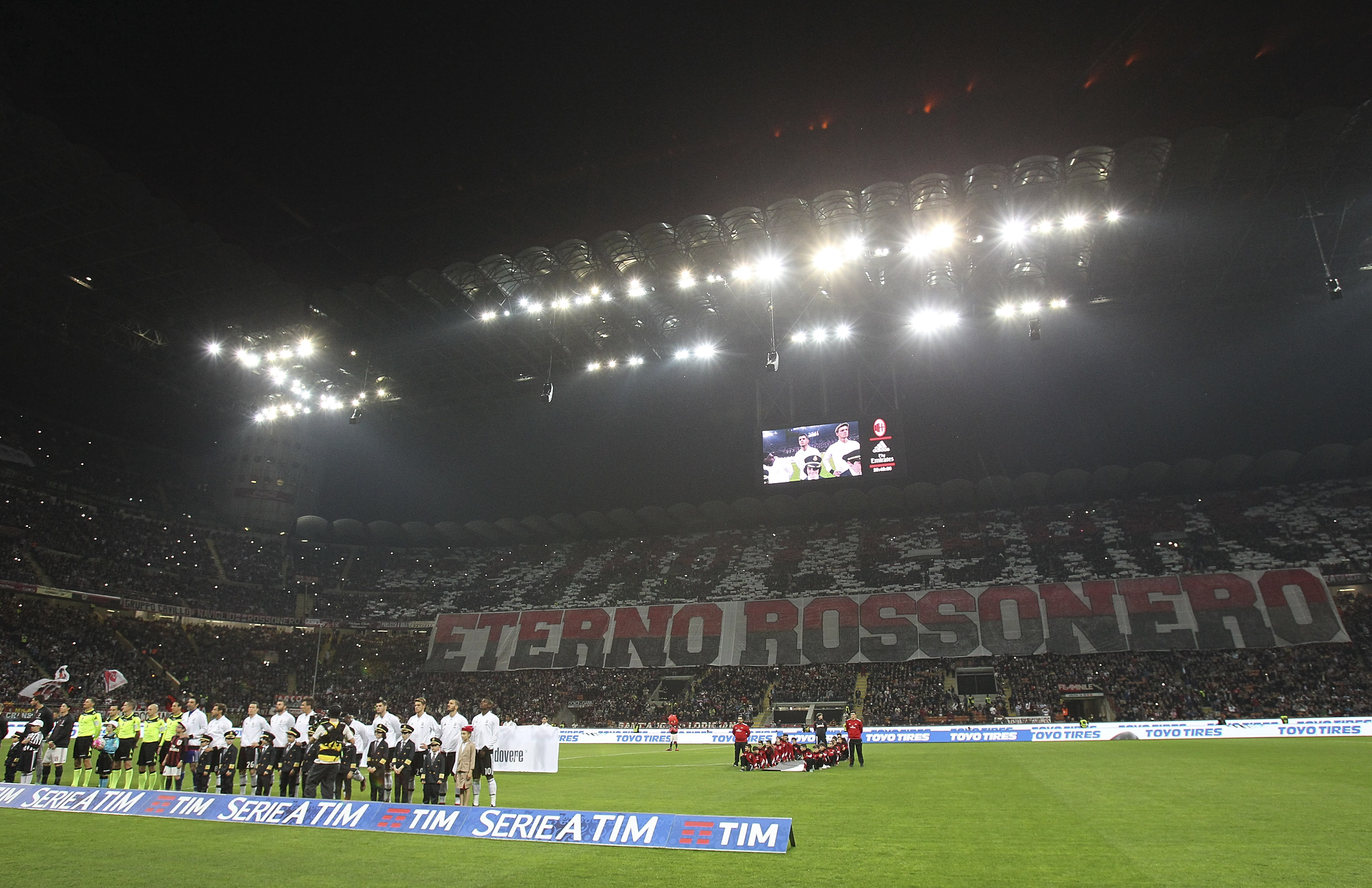 MILAN, ITALY - APRIL 09: AC Milan fans display a giant banner in memory of Cesare Maldini before the Serie A match between AC Milan and Juventus FC at Stadio Giuseppe Meazza on April 9, 2016 in Milan, Italy. (Photo by Marco Luzzani/Getty Images)
