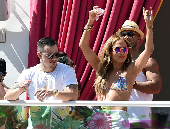 "LAS VEGAS, NV - MAY 29: Choreographer/dancer Beau ""Casper"" Smart (L) looks on as singer/actress Jennifer Lopez dances while hosting the ""Carnival Del Sol"" pool party at Drai's Beach Club - Nightclub at The Cromwell Las Vegas on May 29, 2016 in Las Vegas, Nevada. (Photo by Ethan Miller/Getty Images)"