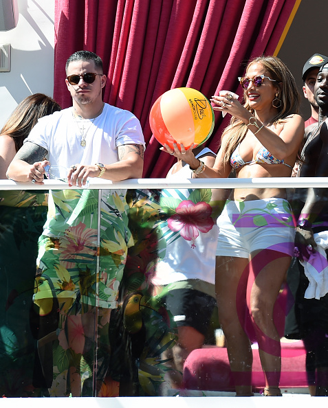 "LAS VEGAS, NM - MAY 29: Choreographer/dancer Beau ""Casper"" Smart (L) looks on as singer/actress Jennifer Lopez prepares to hit a beach ball while hosting the ""Carnival Del Sol"" pool party at Drai's Beach Club - Nightclub at The Cromwell Las Vegas on May 29, 2016 in Las Vegas, Nevada. (Photo by Ethan Miller/Getty Images)"