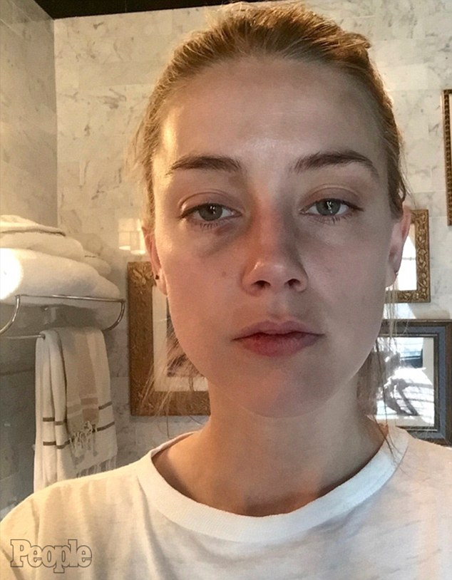34D7B48A00000578-3621330-Bruised_These_shocking_images_are_being_held_up_by_Amber_Heard_a-m-14_1464854374930