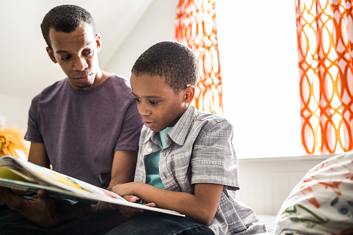Son reading to dad
