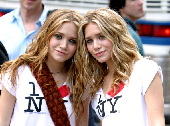 Mary Kate Olsen and Ashley Olsen during New York Minute on Location in Manhattan - October 9, 2003 at Midtown Manhattan in New York City, New York, United States. (Photo by James Devaney/WireImage)