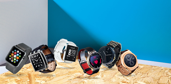 A selection of smart watches, including an Apple Watch, Pebble Steel, Garmin Vivoactive, Alcatel OneTouch, Motorola Moto 360 and an LG Urbane, taken on May 13, 2015. (Photo by Neil Godwin/T3 Magazine via Getty Images)