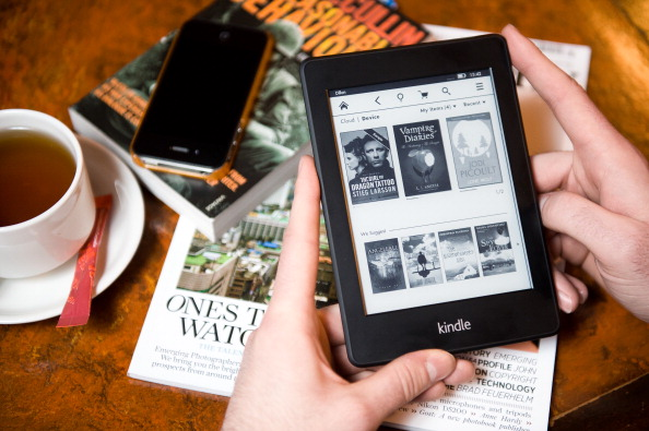 LONDON, UNITED KINGDOM - JANUARY 14: A close-up of a man using a Kindle Paperwhite e-reader in a cafe setting on January 14, 2013. (Photo by Will Ireland/Future Publishing via Getty Images)