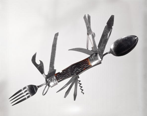 UNITED STATES - Circa 1960s: Retro Large Multi Tool Folding Pocket Knife Fork Spoon Scissors Saw Can Opener Corkscrew Screwdriver Awl. (Photo by H. Armstrong Roberts/Retrofile/Getty Images)