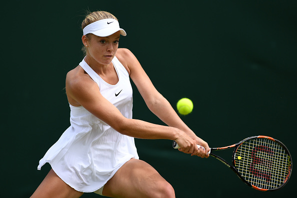 LONDON, ENGLAND - JUNE 28: Katie Swan of Great Britain plays a backhand during the Ladies Singles first round match against Timea Bacsinszky of Switzerland on day two of the Wimbledon Lawn Tennis Championships at the All England Lawn Tennis and Croquet Club on June 28, 2016 in London, England. (Photo by Shaun Botterill/Getty Images)