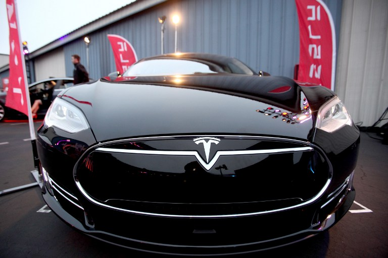 SANTA MONICA, CA - JUNE 17: A general view of a Tesla on display at the Tinder Plus Launch Party featuring Jason Derulo and ZEDD at Hangar 8 Santa Monica at Barker Hangar on June 17, 2015 in Santa Monica, California. Tommaso Boddi/Getty Images for Tinder/AFP