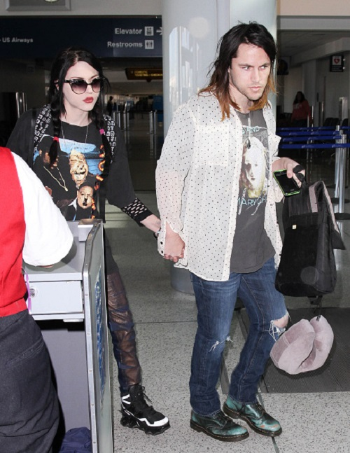 LOS ANGELES, CA - JANUARY 23: Frances Cobain and Isaiah Silva seen at LAX on January 23, 2015 in Los Angeles, California. (Photo by GVK/Bauer-Griffin/GC Images)