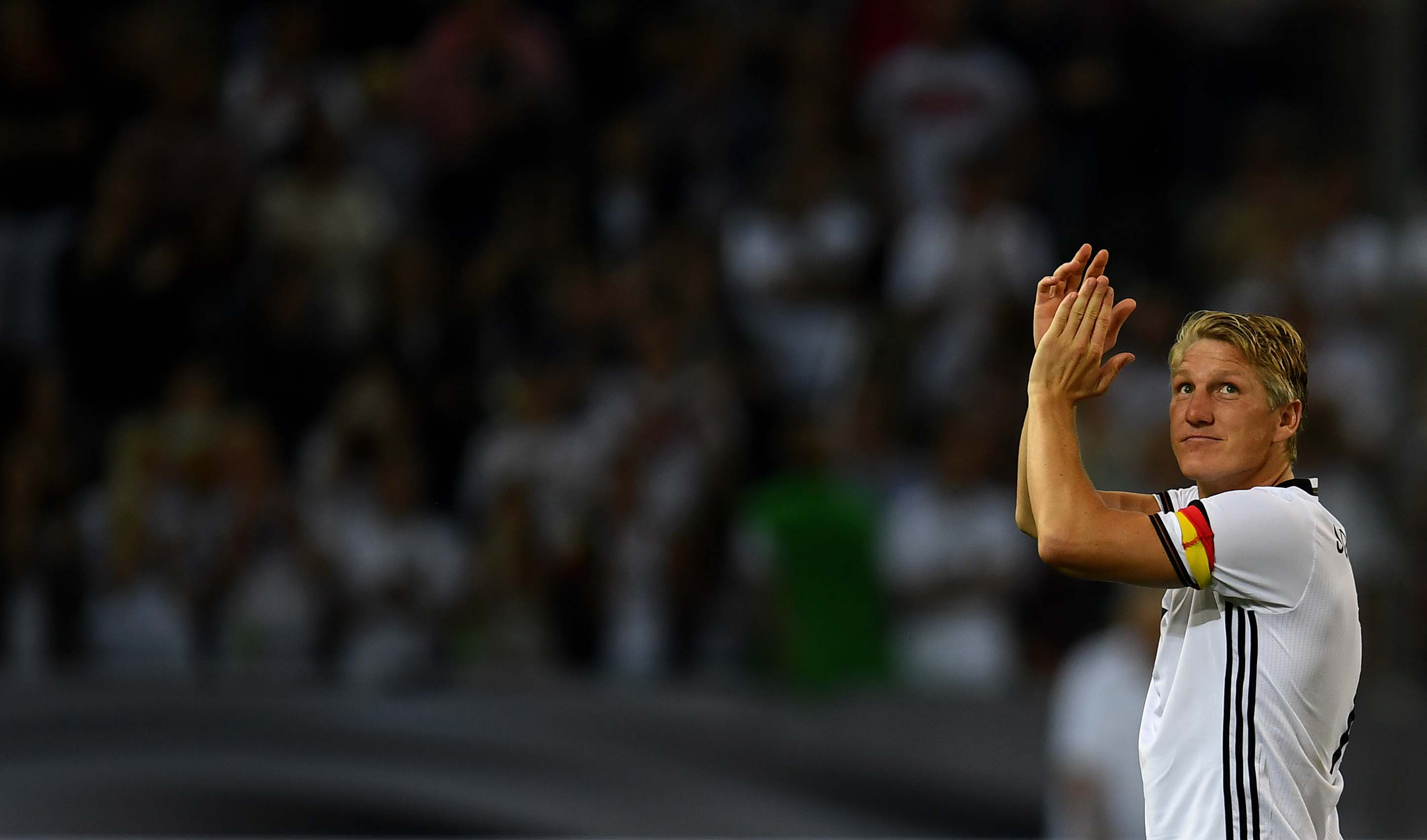 Germany's midfielder Bastian Schweinsteiger applauds after the football friendly match between Germany and Finland, his last game for his country, in Monchengladbach, western Germany on on August 31, 2016. / AFP PHOTO / PATRIK STOLLARZ