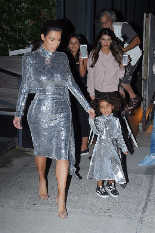 NEW YORK, NY - SEPTEMBER 05: Kim Kardashian and daughter North West seen leaving there Airbnb Apartment in Tribeca in a matching sequin dress on September 05, 2016 in New York, NY. (Photo by Josiah Kamau/BuzzFoto via Getty Images)
