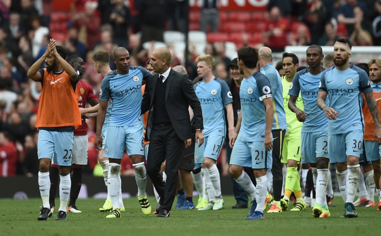 Pep Guardiola celebra triunfo del City