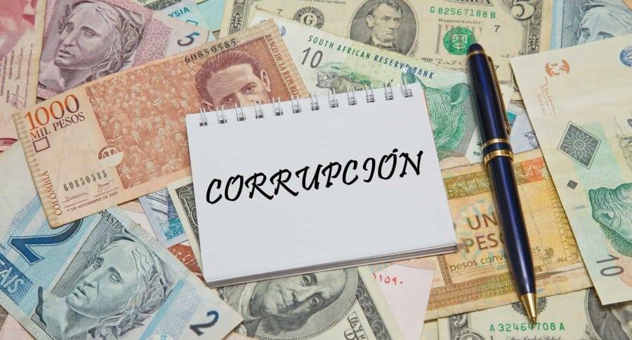 Imagen ilustrativa de la corrupción, con diversas divisas internacionales