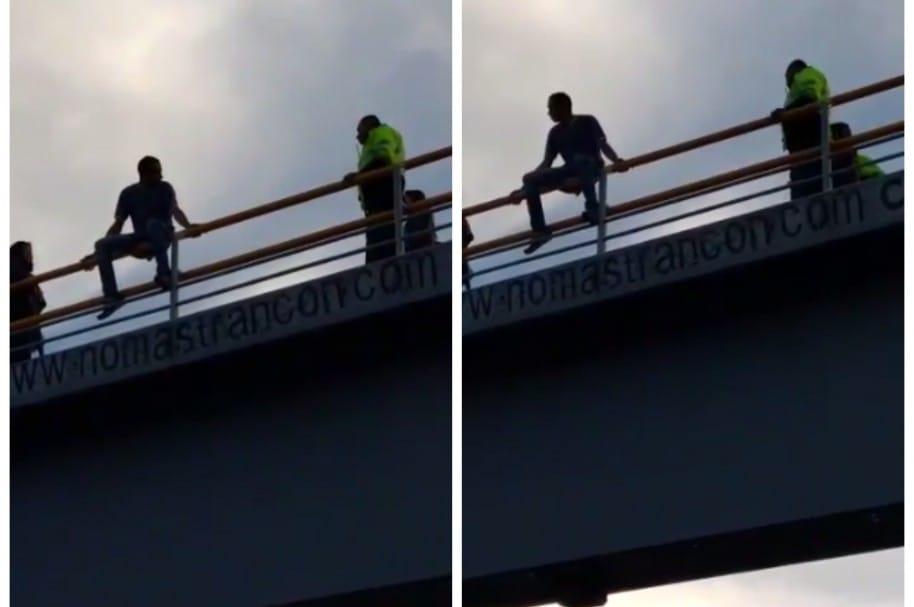 Policía evitar que hombre se lance de puente en Bogotá. Pulzo.com