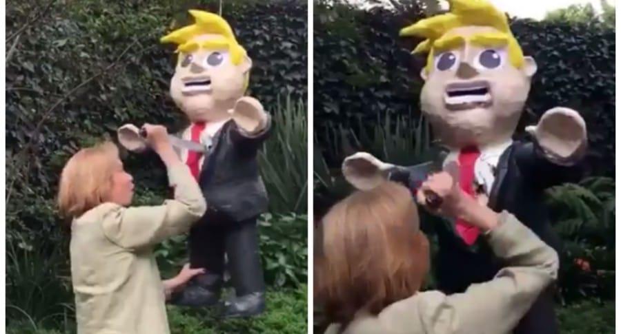 Escritora mexicana Guadalupe Loaeza apuñalando una piñata de Donald Trump. Pulzo.