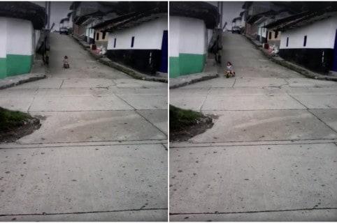 Niña que se cayó cuando bajaba de una calle en triciclo. Pulzo.