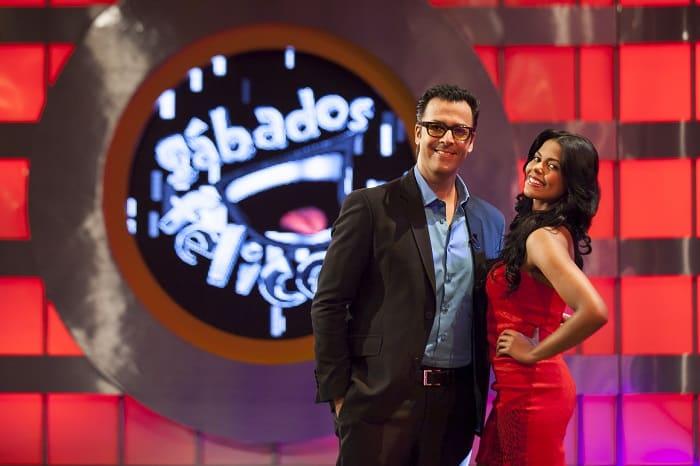 Humberto 'el Gato' Rodríguez y Tahiana Bueno, presentadores.