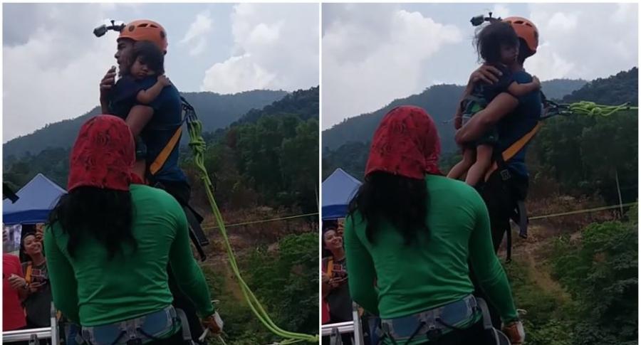 Hombre hace 'bungee jumping' con su hija en brazos.