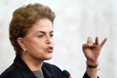 Brazilian President Dilma Rousseff holds a meeting with rectors of public universities and technical education at Planalto Palace in Brasilia, on March 11, 2016. Brazilian President Dilma Rousseff dug in Friday amid a swirling political crisis, insisting she would not resign and adamantly backing her embattled predecessor, Luiz Inacio Lula da Silva. With money-laundering charges against Lula adding to the pressure on her administration, Rousseff rejected calls to stand down, vehemently defended her mentor and said she would even be proud to have him in her cabinet -- a move that could used to protect the ex-president. Rousseff is facing an impeachment drive, a bruising recession, a massive scandal at state oil company Petrobras and a probe into alleged violations of electoral law in her reelection campaign last year.   AFP PHOTO / EVARISTO SA / AFP / EVARISTO SA