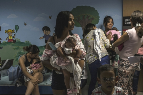 Relatives of patients suffering from microcephaly gather at the Altino Ventura Foundation in Recife, Brazil, on Thursday, Feb. 18, 2016. The mosquito-borne virus Zika, which has been spreading throughout the Americas, has caused alarm and been declared a global health emergency, in large part because of a link to a serious birth defect that leads to abnormally small heads and possible incomplete brain development. Photographer: Dado Galdieri/Bloomberg