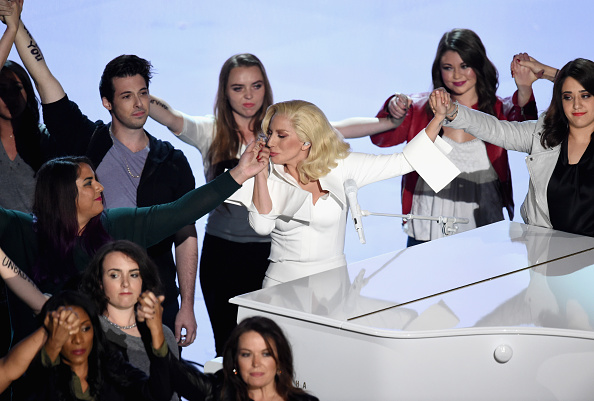 HOLLYWOOD, CA - FEBRUARY 28: Singer-songwriter Lady Gaga (C) performs onstage during the 88th Annual Academy Awards at the Dolby Theatre on February 28, 2016 in Hollywood, California. (Photo by Kevin Winter/Getty Images)