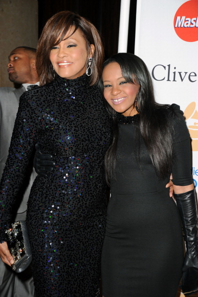 BEVERLY HILLS, CA - FEBRUARY 12:  Singer Whitney Houston (L) and Bobbi Kristina Brown arrives at the 2011 Pre-GRAMMY Gala and Salute To Industry Icons Honoring David Geffen at Beverly Hilton on February 12, 2011 in Beverly Hills, California.  (Photo by Jason Merritt/Getty Images)