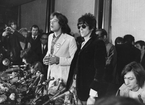 UNITED STATES - NOVEMBER 28: Mick Jagger (left), lead singer of the Rolling Stones, at news conference with Keith Richards and drummer Charlie Watts (seated at right). (Photo by Mel Finkelstein/NY Daily News Archive via Getty Images)