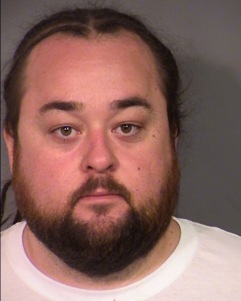 LAS VEGAS, NV - MARCH 09: (EDITORS NOTE: Best resolution available) In this handout photo provided by the Las Vegas Metropolitan Police Department, Austin 'Chumlee' Russell is seen in a booking photo after his arrest for possession of a firearm and numerous narcotics including methamphetamine and marijuana during a sexual assault investigation raid at his home on March 9, 2016 in Las Vegas, Nevada. Chumlee has not been charged in connection to the sexual assault investigation. (Photo by Las Vegas Metropolitan Police Department via Getty Images)