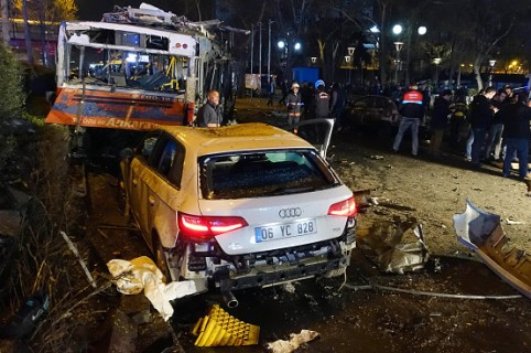 ANKARA, TURKEY - MARCH 13:  (TURKEY OUT) Emergency workers work at the explosion site March 13, 2016 in  in Ankara, Turkey. At least 27 people were killed and 75 wounded in an explosion in the Turkish capital Ankara in what appeared to have been a car bomb attack according to Ankara governor Mehmet Kiliclar. (Photo by Erhan Ortac/Getty Images)