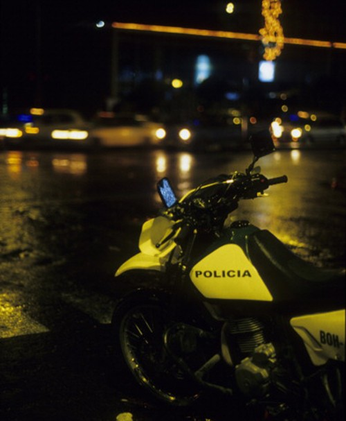 COLOMBIA - CIRCA 1900:  Police Motorbike in the Streets at Night, in Bogota, Colombia.  (Photo by Veronique DURRUTY/Gamma-Rapho via Getty Images)